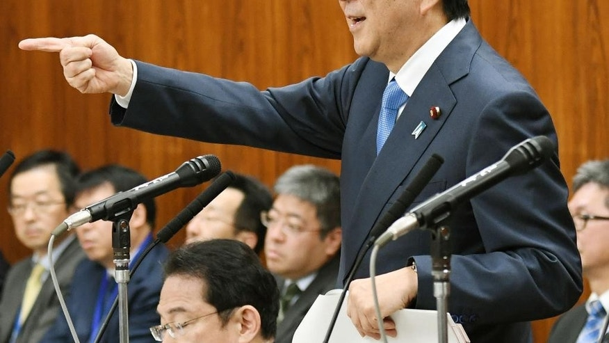 Japanese Prime Minister Shinzo Abe gestures while speaking at a parliamentary panel on national security and diplomacy at parliament's upper house in Tokyo Thursday, April 13, 2017. Abe warned that North Korea may be capable of firing a missile loaded with sarin nerve gas toward Japan. Abe's comments come amid looming concern about another missile or nuclear test by the communist country. (Yoshinobu Shimizu/Kyodo News via AP)