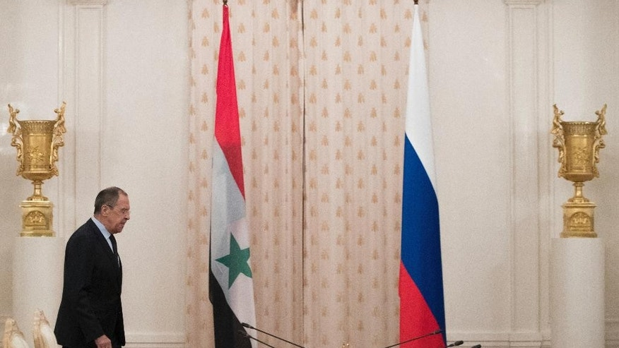Russian Foreign Minister Sergey Lavrov arrives for talks with Syrian counterpart Walid Muallem in Moscow, Russia, on Thursday, April 13, 2017.  Lavrov said he expected the OPCW ( Organization for the Prohibition of Chemical Weapons ) to conduct an extensive probe into the suspected nerve gas attack on Khan Sheikhoun, Syria, which could produce a report  within about three weeks,  the British delegation to the commission said Thursday. (AP Photo/Pavel Golovkin)