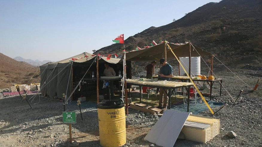 This March 1, 2017 photo, shows the research tent of the Oman Drilling Project, in the al-Hajjar mountains of Oman. Deep in the jagged red mountains, the geologists are drilling in search of the holy grail of reversing climate change: an efficient and cheap way to remove carbon dioxide from the air and oceans.They are coring samples from one of the world's only exposed sections of the Earth's mantle to uncover how a spontaneous natural process millions of years ago transformed CO2 into limestone and marble. (AP Photo/Sam McNeil)