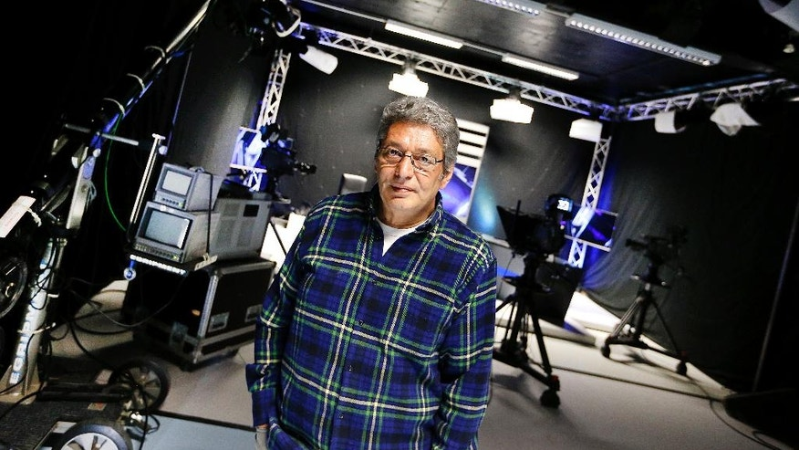 In this April 11, 2017 photo Arti TV editor-in-chief Celal Baslangic poses for a photo in the studio in Cologne, Germany. Baslangic wants to bring fact-based reporting to Turks in Turkey and in Germany. (AP Photo/Michael Probst)