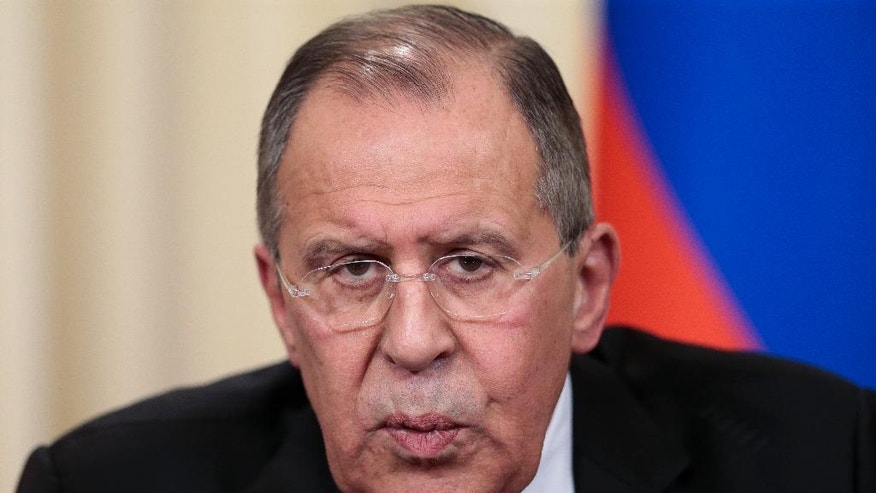 Russian Foreign Minister Sergey Lavrov speaks to the media during a shared news conference with US Secretary of State Rex Tillerson following their talks in Moscow, Russia, Wednesday, April 12, 2017. Amid a fierce dispute over Syria, the United States and Russia agreed Wednesday to work together on an international investigation of a Syrian chemical weapons attack last week. (AP Photo/Ivan Sekretarev)
