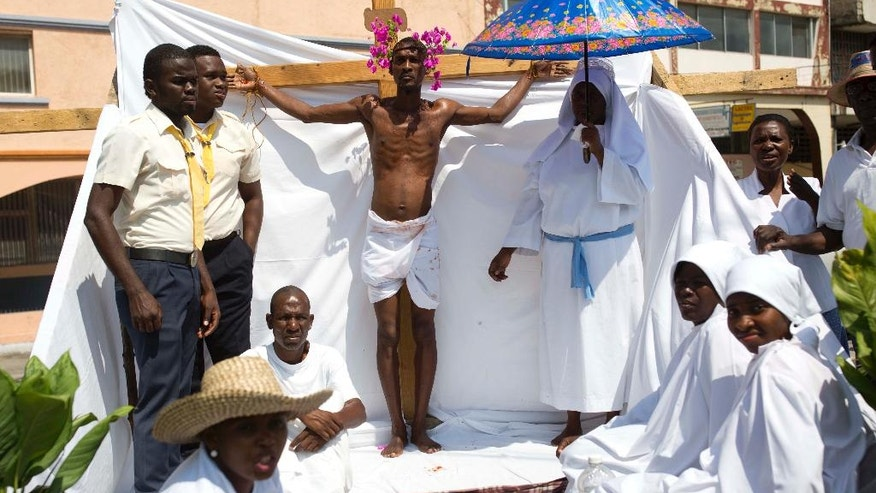 Parishioners reenact Jesus Christ's final hours during the a Good Friday event in Port-au-Prince, Haiti, Friday, April 14, 2017. Millions worldwide attend mock crucifixions and passion plays that mark the day Jesus was crucified, known to Christians as Good Friday. (AP Photo/Dieu Nalio Chery)