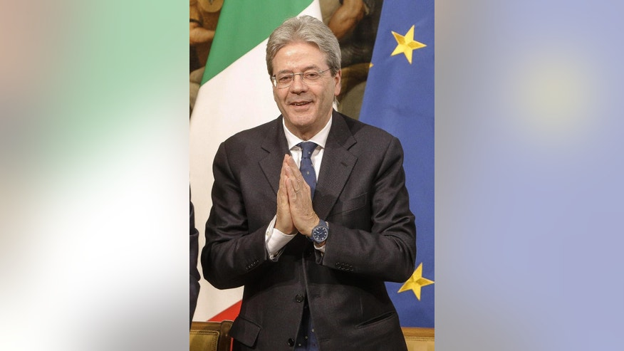 Italian Premier Paolo Gentiloni gestures during a press conference at Chigi Palace in Rome, Italy, Friday,  April 14, 2017. Gentiloni urged Alitalia workers on Friday to approve a compromise deal to relaunch Italy's struggling flagship airline that was reached in last-ditch, government-mediated negotiations between unions and Alitalia management.  (Giuseppe Lami/ANSA via AP)