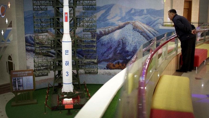 A North Korean man looks at a model of the Unha 3 space launch vehicle displayed at the Mangyongdae Children's Palace on Friday, April 14, 2017, in Pyongyang, North Korea. Amid rising regional tensions, Pyongyang residents have been preparing for North Korea's most important holiday: the 105th birth anniversary of Kim Il Sung, the country's late founder and grandfather of current ruler Kim Jong Un. (AP Photo/Wong Maye-E)