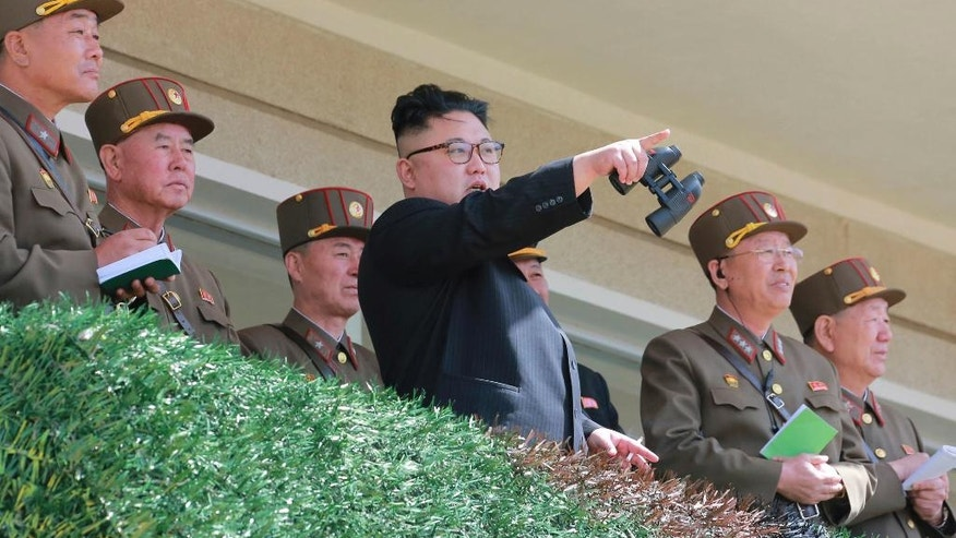 In this undated photo distributed on Friday, April 14, 2017, by the North Korean government, North Korean leader Kim Jong Un, center, watches a military drill at an undisclosed location.  Independent journalists were not given access to cover the event depicted in this photo, distributed via the Korean Central News Agency and the Korea News Service. Tensions are deepening as the U.S. has sent the USS Carl Vinson to waters off the Korean peninsula and is conducting its biggest-ever joint military exercises with South Korea. North Korea recently launched a ballistic missile and some experts say it could conduct another nuclear test at virtually anytime. (Korean Central News Agency/Korea News Service via AP)