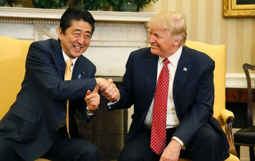 Japanese Prime Minister Shinzo Abe shakes hands with U.S. President Donald Trump (R) during their meeting in the Oval Office at the White House in Washington, U.S., February 10, 2017.    REUTERS/Jim Bourg   TPX IMAGES OF THE DAY   - RTX30HPZ