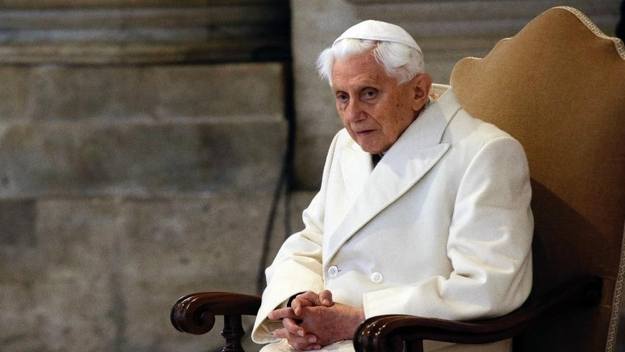 "FILE - In this Tuesday, Dec. 8, 2015. filer, Pope Emeritus Benedict XVI attends a Mass prior to the opening of the Holy Door of St. Peter's Basilica, formally starting the Jubilee of Mercy, at the Vatican. A ""modest"" 90th birthday party is being planned for Benedict XVI, who stunned the Catholic church by resigning in 2013. His aide, Monsignor Georg Gaenswein, says Benedict's birthday, which falls on Easter Sunday this year, will be celebrated on Monday in Bavarian style in keeping with the emeritus pontiff's roots. (AP Photo/Gregorio Borgia, File)"