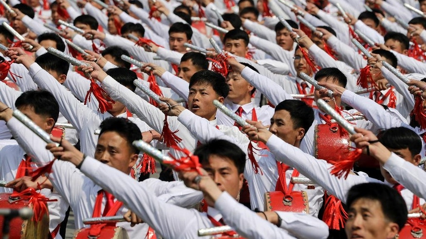 North Korean men beat drums as they parade across Kim Il Sung Square during a military parade on Saturday, April 15, 2017, in Pyongyang, North Korea to celebrate the 105th birth anniversary of Kim Il Sung, the country's late founder and grandfather of current ruler Kim Jong Un. (AP Photo/Wong Maye-E)