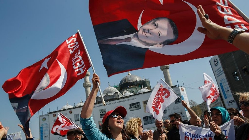 "Supporters of the ""YES"" vote wave banners with Erdogan's images as they campaign ahead of the Sunday referendum, in Istanbul, Friday, April 14, 2017. Turkey is heading to a contentious April 16 referendum on constitutional reforms to expand President Recep Tayyip Erdogan's powers. (AP Photo/ Emrah Gurel)"