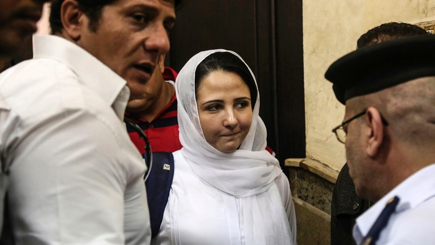 Aya Hijazi, center, a dual U.S.-Egyptian citizen, is acquitted by an Egyptian court after nearly three years of detention over accusations related to running a foundation dedicated to helping street children, Cairo, Sunday,  April 16, 2017. Egyptian authorities arrested Hijazi, her husband and six others in May 2014 on charges of abusing children in her care and engaging in human trafficking, kidnapping, sexual exploitation and torture. (AP Photo/Mohamed el Raai)