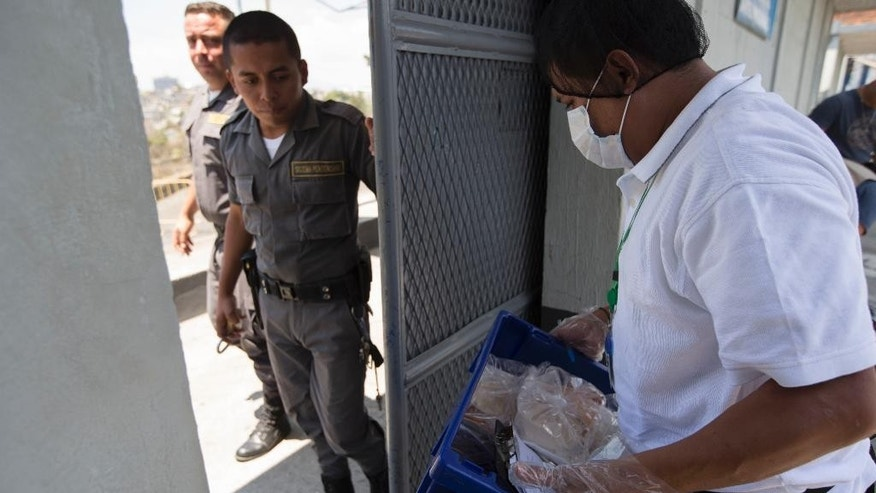 A man delivers food for inmates at Guatemala City's Matamoros prison where Mexico's former Veracruz state Gov. Javier Duarte is detained, Sunday, April 16, 2017. Duarte, who is accused of running a ring that allegedly pilfered from state coffers, has been detained in Guatemala after six months as a fugitive and a high-profile symbol of government corruption. (AP Photo/Moises Castillo)