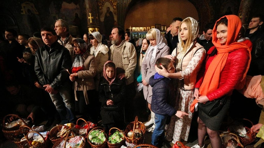 Ukrainian Orthodox believers attend an Orthodox Easter service in the Kyiv-Pechersk Lavra church, also known as the Kiev Monastery of the Caves, in the capital city of Kiev, Ukraine, Sunday, April 16, 2017. (AP Photo/Sergei Chuzavkov)
