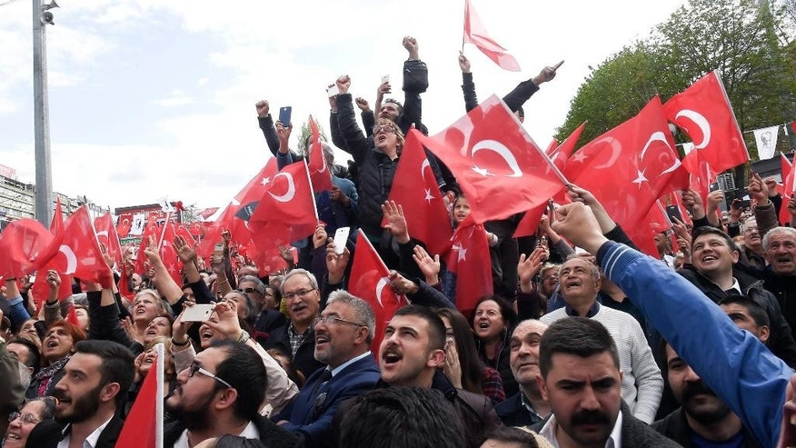 "Supporters of Turkey's main opposition Republican People's Party leader Kemal Kilicdaroglu cheer as they listen to him during a last referendum rally in Ankara, Turkey, Saturday, April 15, 2017. Campaigning for Turkey's crucial referendum on whether to expand presidential powers entered its final stretch Saturday, with supporters of both ""yes"" and ""no"" campaigns addressing flag-waving supporters in Turkey's two main cities of Istanbul and Ankara. (AP Photo)"