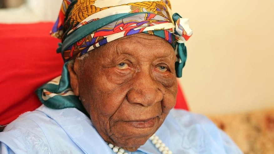 The world's oldest person Violet Brown poses for a photo at her home in Duanvale, Jamaica, Sunday, April 16, 2017. The 117-year-old woman living in the hills of western Jamaica  is believed to have become the world's oldest person, according to groups that monitor human longevity. (AP Photo/Raymond Simpson)