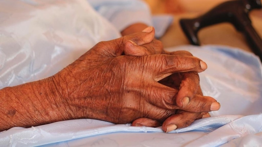 The world's oldest person Violet Brown clasps her hands at her home in Duanvale, Jamaica, Sunday, April 16, 2017. The 117-year-old woman living in the hills of western Jamaica  is believed to have become the world's oldest person, according to groups that monitor human longevity. (AP Photo/Raymond Simpson)