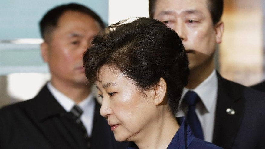 FILE - In this March 30, 2017 file photo, former South Korean President Park Geun-hye arrives at the Seoul Central District Court for hearing on a prosecutors' request for her arrest for corruption, in Seoul, South Korea. South Korean prosecutors on Monday, April 17 indicted Park on high-profile corruption charges that could potentially send her to jail for life. (AP Photo/Ahn Young-joon, Pool, File)
