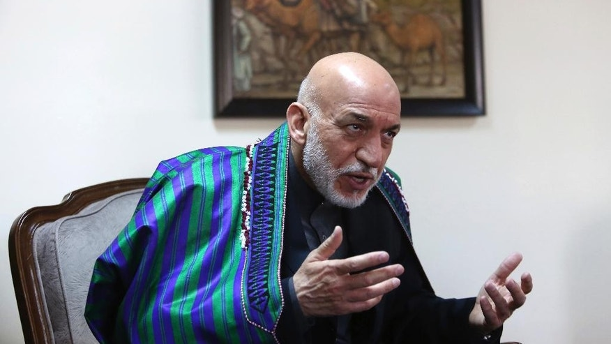 "Former Afghan President Hamid Karzai speaks during an interview with the Associated Press in Kabul, Afghanistan, Monday, April 17, 2017.  Karzai said that the U.S. is using Afghanistan as a weapons testing ground, calling the recent use of the largest-ever non-nuclear bomb ""an immense atrocity against the Afghan people."" Last week, U.S. forces dropped the GBU-43 Massive Ordnance Air Blast (MOAB) bomb in Nangarhar province, reportedly killing 95 militants. (AP Photo/Rahmat Gul)"