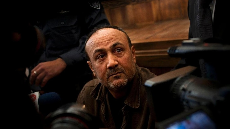 FILE - In this Jan. 25, 2012 file photo, jailed Senior Fatah leader Marwan Barghouti appears in a Jerusalem court. Qadoura Fares, an advocate for prisoners' rights, said Monday, April 17, 2027, that more than 1,500 Palestinian prisoners have launched an open-ended hunger strike to demand better conditions in Israeli prisons, including more contact with relatives, and an end to Israel's practice of detentions without trial. The protest began Tuesday and was led by Marwan Barghouti, imprisoned since 2002. (AP Photo/Bernat Armangue, File)