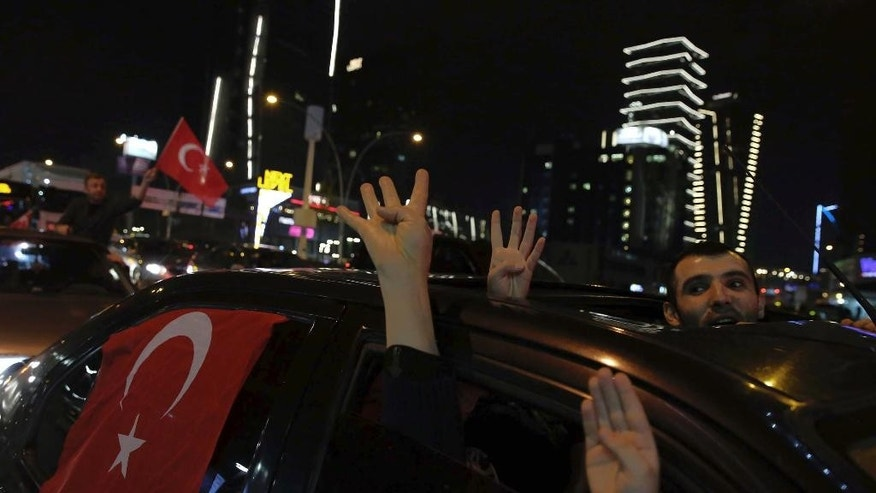 "Supporters of President Recep Tayyip Erdogan celebrate in Ankara, Turkey, early Monday, April 17, 2017. Turkey's main opposition Republican People's Party leader Kemal Kilicdaroglu has raised objections to the actions of the country's electoral board in the conduct of Sunday's referendum on whether to expand the powers of the president. Kilicdaroglu said the Supreme Electoral Board had ""rendered the referendum polemical "" with announcement that it would accept as valid ballots cast without official stamps.(AP Photo/Ali Unal)"