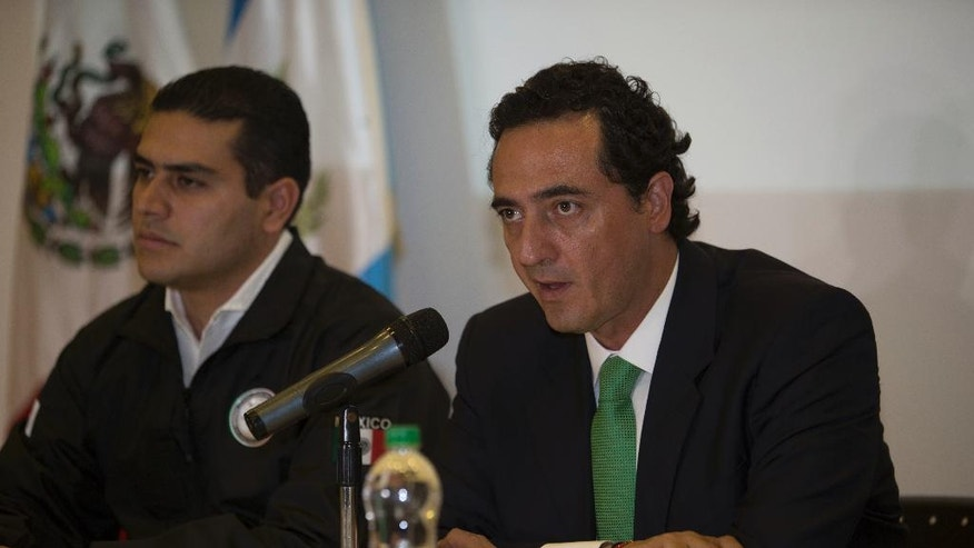 Alberto Elias Beltran, right, and Omar Garcia Harfuch of Mexico's Federal Attorney General's Office speak during a press conference at the Mexican embassy in Guatemala City, Sunday, April 16, 2017. Mexico's former Veracruz state Gov. Javier Duarte, who is accused of running a ring that allegedly pilfered from state coffers, has been detained in Guatemala after six months as a fugitive and a high-profile symbol of government corruption. (AP Photo/Moises Castillo)