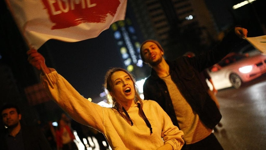 Supporters of pro-'no' vote chant slogans as they protest against the referendum outcome, in Istanbul, early Monday, April 17, 2017. Hundreds of demonstrators marched in a central neighbourhood in Istanbul, clanking pots and pans and chanting 'this is just the beginning, the struggle will continue'. (AP Photo/Emrah Gurel)