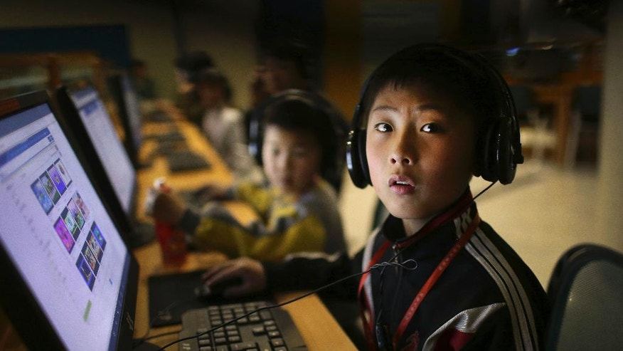 A North Korean school boy looks up from his computer screen at the Sci-Tech Complex during a press tour for foreign journalist who are in Pyongyang to cover the 105th birth anniversary of the late Kim Il Sung, Monday, April 17, 2017, in Pyongyang, North Korea. Tensions have spiked in recent weeks over North Korea's advancing nuclear technology and missile arsenal. But in Pyongyang, where war would mean untold horrors, where neighborhoods could be reduced to rubble and tens of thousands of civilians could be killed, few people seem to care much at all. (AP Photo/Wong Maye-E)