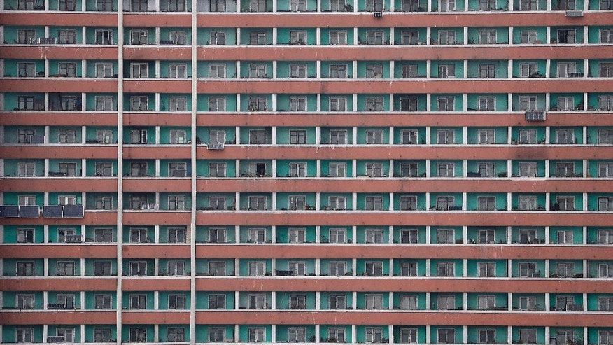 Black oblong boards which look like solar panels are seen outside some of the households of a residential building Monday, April 17, 2017, in Pyongyang, North Korea. Tensions have spiked in recent weeks over North Korea's advancing nuclear technology and missile arsenal. But in Pyongyang, where war would mean untold horrors, where neighborhoods could be reduced to rubble and tens of thousands of civilians could be killed, few people seem to care much at all. (AP Photo/Wong Maye-E)