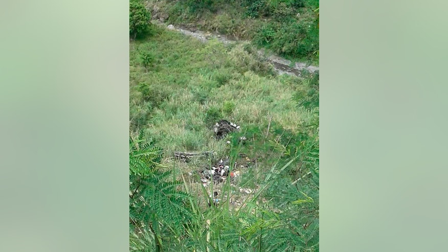 Volunteers try to rescue passengers after a bus plunged into a deep ravine in Carranglan township, Nueva Ecija province in northern Philippines Tuesday, April 18, 2017. The bus lost its brakes and plunged into a deep ravine, killing dozens in one of the country's deadliest road accidents in years, officials said. (AP Photo)