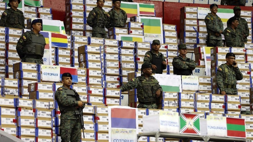 Soldiers guard marked ballots to be recounted in Quito, Ecuador, Tuesday, April 18, 2017. The National Electoral Council announced late Thursday it would recount all ballots, contested by both parties, about 10 percent of the total vote of the April 2 presidential runoff. (AP Photo/Dolores Ochoa)