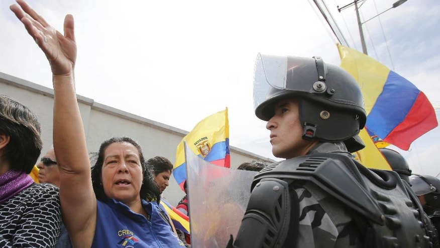 Supporters of CREO's presidential candidate Guillermo Lasso protest in front of the Ruminahui Coliseum where members of Ecuador's National Electoral Council are conducting a recount, in Quito, Ecuador, Tuesday, April 18, 2017. The council announced it would recount all ballots, contested by both parties, about 10 percent of the total vote of the April 2 presidential runoff. (AP Photo/Dolores Ochoa)