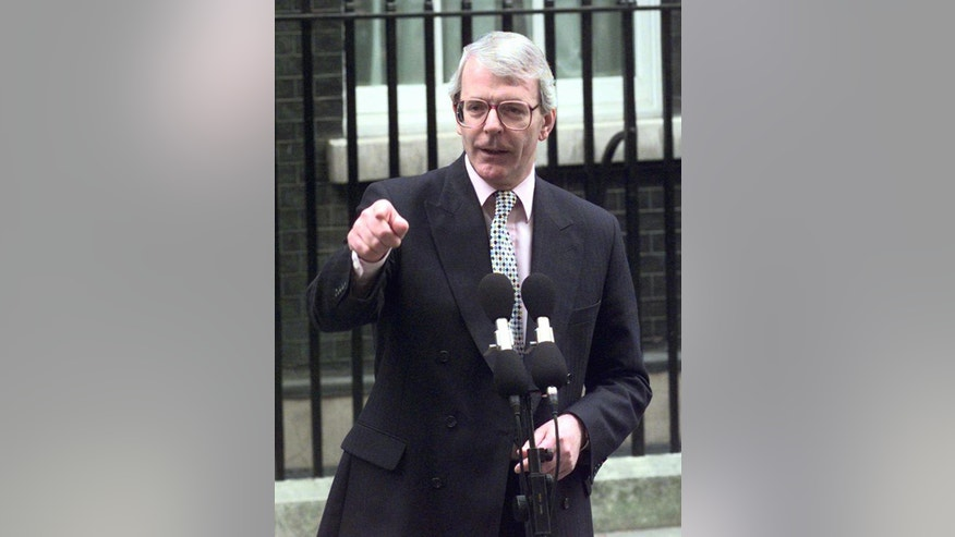 FILE- In this Monday March 17, 1997 file photo, the then British Prime Minister John Major calls a national election for May 1 outside of 10 Downing Street. After ten years as the country's finance minister, Brown's premiership will always be marked out by the global financial crisis and the recession that followed.  (AP Photo/Max Nash, File)
