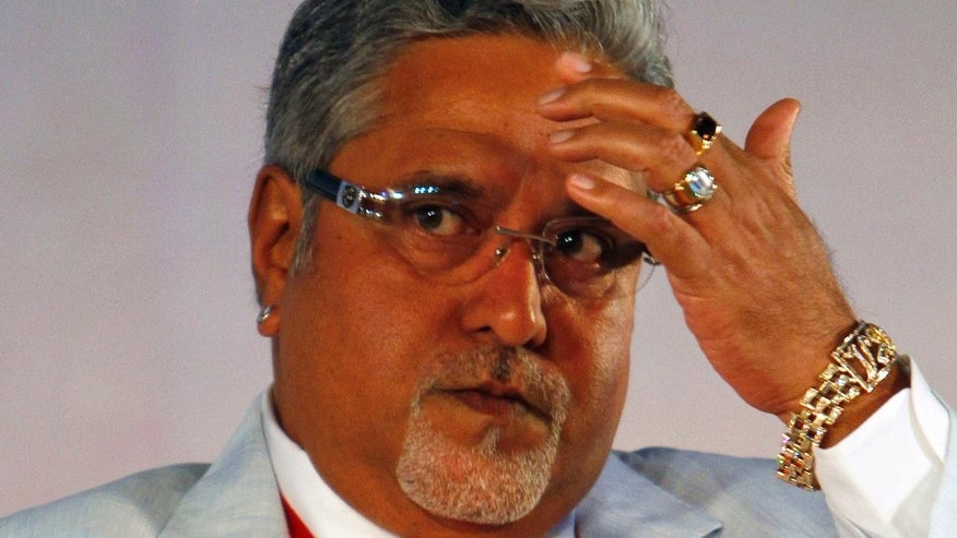 In this June 3, 2010 file photo, United Breweries Group Chairman Vijay Mallya attends the Global Investors Meet organized by Karnataka state government in Bangalore, India. British police said Tuesday, April 18, 2017, they have arrested Indian business tycoon Vijay Mallya in London. (AP Photo/Aijaz Rahi, File)