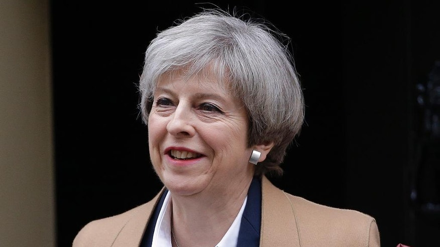 FILE - In this file photo dated Wednesday March 29, 2017, Britain's Prime Minister Theresa May leaves 10 Downing Street on her way to parliament, London.  Theresa May is due to make an unexpected statement in Downing Street, Tuesday April 18, 2017, triggering widespread speculation about the reason for the statement. (AP Photo/ Alastair Grant, FILE)