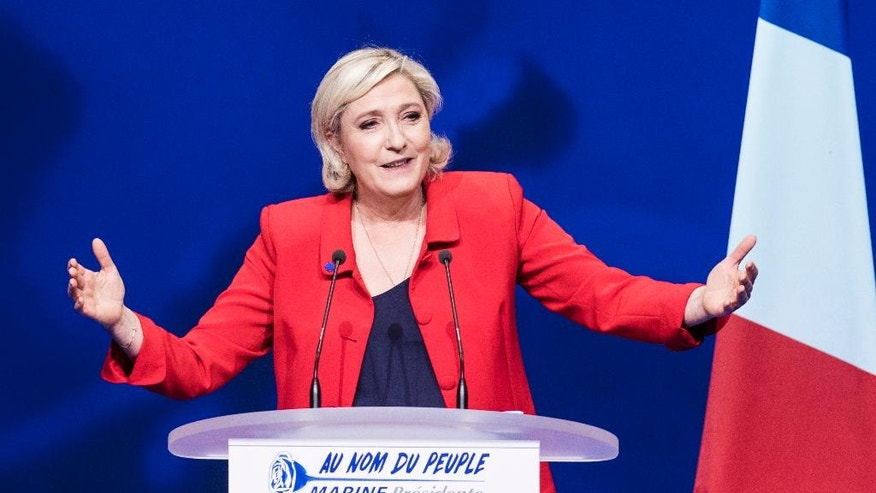 Far-right candidate for the presidential election Marine Le Pen speaks during a campaign meeting in Paris, France, Monday, April 17, 2017. As France's unpredictable presidential campaign nears its finish with no clear front-runner, centrist candidate Emmanuel Macron and far-right leader Marine Le Pen hope to rally big crowds in Paris with their rival visions for Europe's future. (AP Photo/Kamil Zihnioglu)