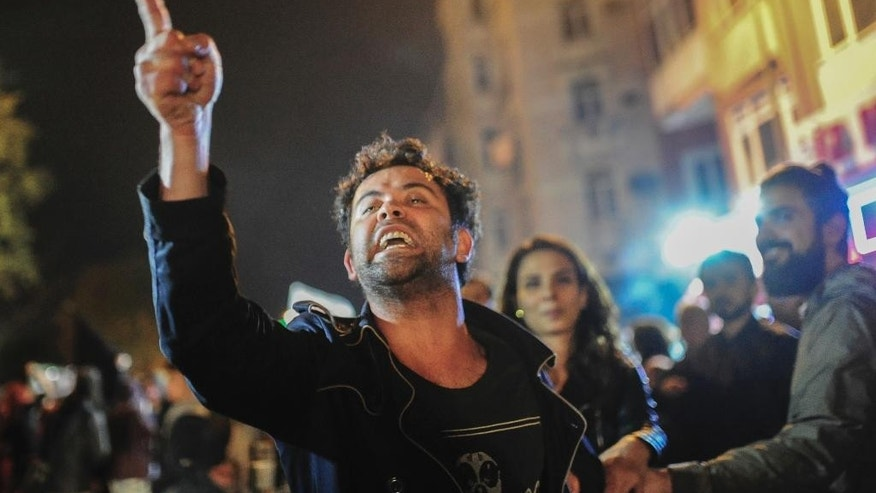 Supporters of pro-'no' vote chant slogans as they protest in Istanbul, against the referendum outcome, early Monday, April 17, 2017. Hundreds of demonstrators marched in a central neighbourhood, clanking pots and pans and chanting 'this is just the beginning, the struggle will continue'. (AP Photo/Cansu Alkaya)