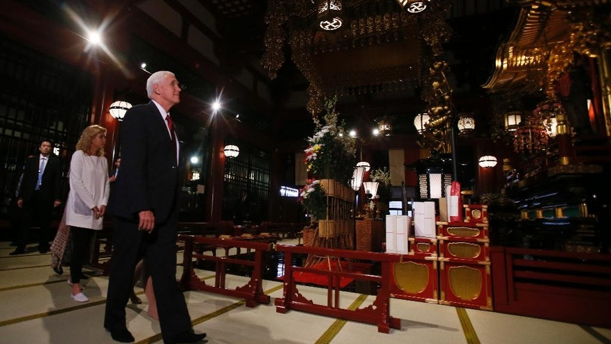 U.S. Vice President Mike Pence visits the main shrine of Sensoji Buddhist temple in Tokyo, Tuesday, April 18, 2017. (AP Photo/Shuji Kajiyama)