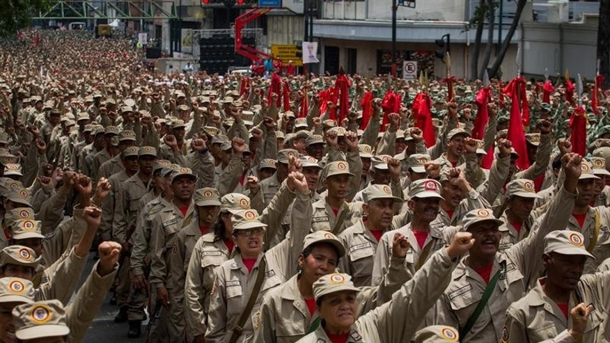 "The Bolivarian militias were first created by the late Hugo Chavez to assist the armed forces in the defense of his ""revolution."""