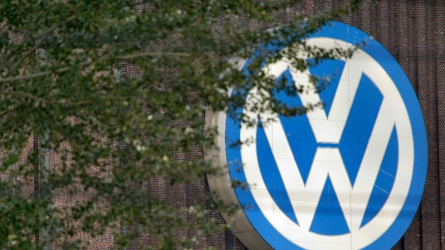 FILE - In this Sept. 26, 2015 file photo, trees stand in front of a giant logo of the German car manufacturer Volkswagen in Wolfsburg, Germany. German automaker Volkswagen is reporting better-than-expected operating earnings for the first quarter thanks to cost controls and a stronger contribution from its core brand, which was boosted by new models including the Tiguan SUV the company said Tuesday, April 18, 2017.  (AP Photo/Michael Sohn,file)