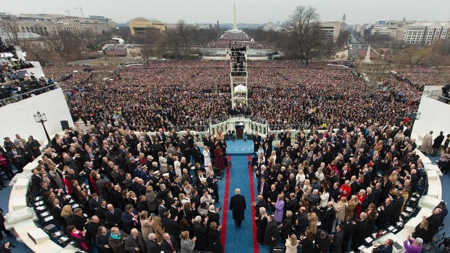 FILE - In this Jan. 20, 2017 file photo, President-elect Donald Trump arrives during the 58th Presidential Inauguration at the U.S. Capitol in Washington. Venezuela President Nicolas Maduro's administration made a $500,000 donation to Donald Trump's inauguration. Inaugural committee records filed with the Federal Election Commission show Citgo Petroleum, a U.S. affiliate of Venezuela's state oil company PDVSA, was one of the biggest corporate donors to events surrounding the swearing-in ceremony. (AP Photo/Carolyn Kaster, File)