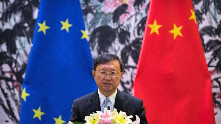 Chinese State Councilor Yang Jiechi speaks during a joint press conference with Federica Mogherini High Representative of the European Union for Foreign Affairs and Security Policy at the Diaoyutai State Guesthouse in Beijing Wednesday
