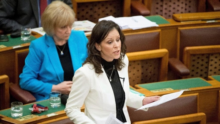 Co-chairman and parliamentary faction leader of LMP (Politics Can Be Different) green-liberal party, Bernadett Szel, speaks during the general debate regarding the proposed legislation on the transparency of foreign-funded NGOs  at the parliament in Budapest, Hungary, Wednesday, April 19, 2017. (Szilard Koszticsak/MTI via AP)