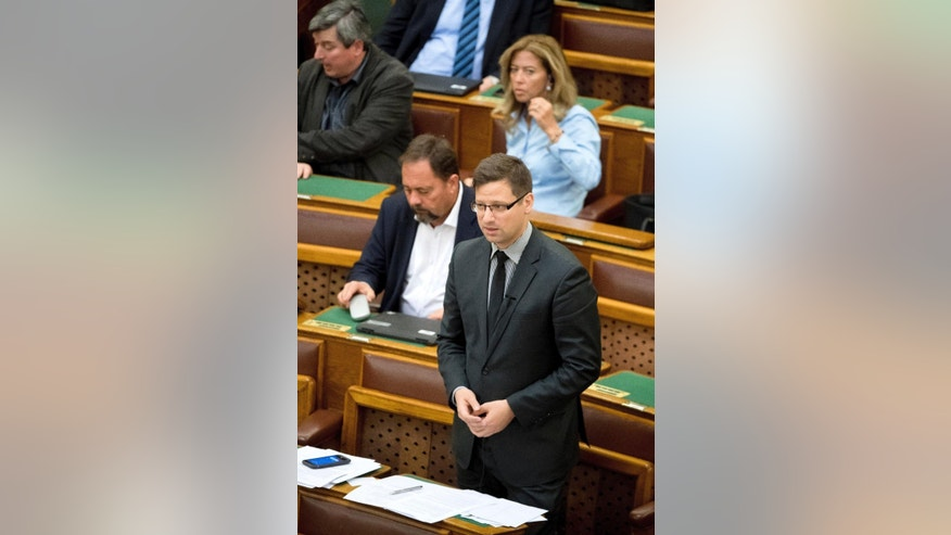 Deputy faction leader of Fidesz - Hungarian Civic Alliance, Gergely Gulyas, participates in the general debate  regarding the proposed legislation on the transparency of foreign-funded NGOs during the plenary session of the parliament in Budapest, Hungary, Wednesday, April 19, 2017. (Szilard Koszticsak/MTI via AP)