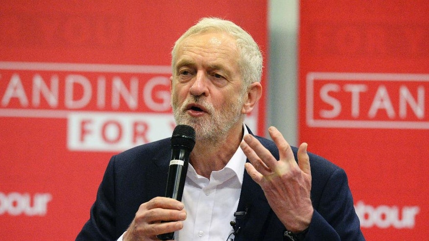 Britain's Labour leader Jeremy Corbyn speaks at a meeting about social care in Birmingham central England Tuesday April 18, 2017.  In a shock announcement, Britain's Prime Minister Theresa May on Tuesday called for an early general election to be held June 8 to seek a strong mandate as she negotiates Britain's exit from the European Union. (Ben Birchall/PA via AP)