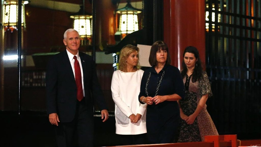U.S. Vice President Mike Pence, left, and his wife Karen, second from right, with their daughters Audrey, right, and Charlotte visit the main shrine of Sensoji Buddhist temple in Tokyo, Tuesday, April 18, 2017. (AP Photo/Shuji Kajiyama)
