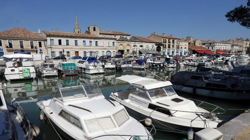 Boats dock along the Rhone Canal in Beaucaire, southern France, Monday April 3, 2017. Beaucaire, a town of 16,000 people about 30 kilometers (19 miles) from Nimes, was fertile ground for the National Front, which campaigns on concerns about France's identity as much as its economy. (AP Photo/Claude Paris)