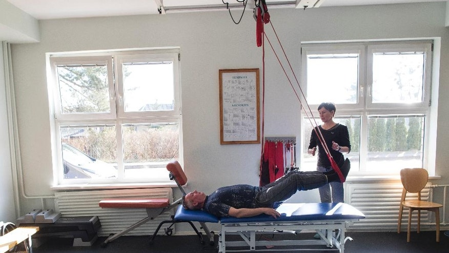 CORRECTS SPELLING OF NAME  Ukrainian army officer Oleksander Valevich performs therapeutic exercise at the Military rehabilitation center in Druskininkai some 130 km. (81 miles) southwest of the capital Vilnius, Lithuania, Tuesday, March 28, 2017. More than 130 Ukrainian officers and soldiers received treatment and rehabilitation at the medical institutions of Lithuania . (AP Photo/Mindaugas Kulbis)