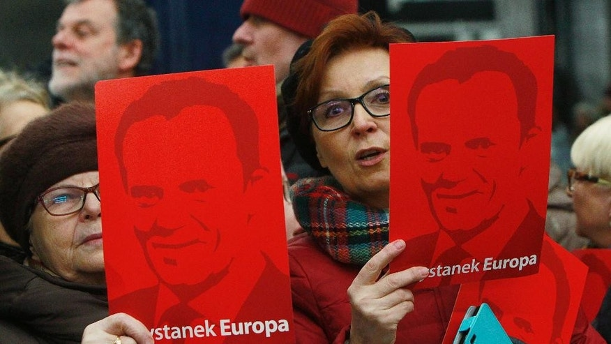 Supporters of former Polish Prime Minister and now European Council President Donald Tusk gathered at the Central Railway Station in Warsaw, Poland, Wednesday, April 19, 2017. Tuske has to testify in an investigation into an alleged secret deal between Polish and Russian intelligence officials. He is to be questioned by prosecutors in Warsaw as a witness. (AP Photo/Czarek Sokolowski)