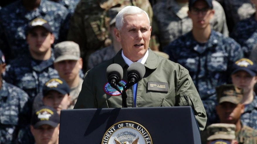 U.S. Vice President Mike Pence speaks to U.S. servicemen and Japanese Self-Defense Forces personnel on the flight deck of U.S. navy nuclear-powered aircraft carrier USS Ronald Reagan at the U.S. Navy's Yokosuka base in Yokosuka, south of Tokyo, Wednesday, April 19, 2017. (AP Photo/Eugene Hoshiko)