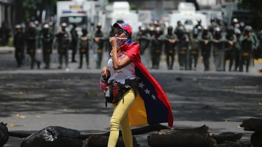 "A demonstrator walks along a barricade set up during opposition protesters in Caracas, Venezuela, Wednesday, April 19, 2017. Opponents of President Nicolas Maduro called on Venezuelans to take to the streets on Wednesday for what they dubbed the ""mother of all marches"" against the embattled socialist leader. Government supporters are holding their own counter demonstration. (AP Photo/Fernando Llano)"