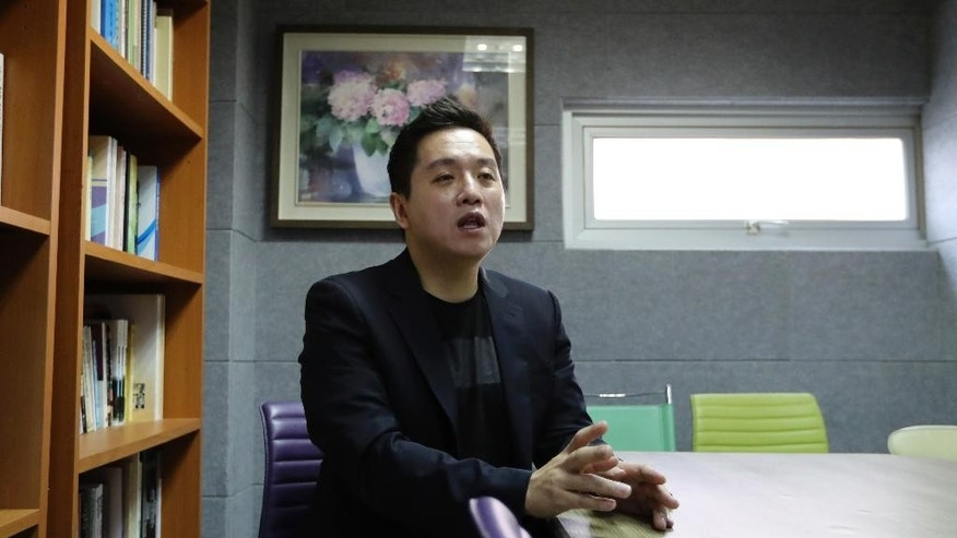 Taehoon Lim, the head of the Military Human Rights Center for Korea, speaks during an interview in Seoul, South Korea, Friday, April 21, 2017. A watchdog group says South Korea's army is hunting down and prosecuting gay servicemen after a video of two male soldiers having sex was posted on the internet earlier this year, stoking fear in an already persecuted minority group. (AP Photo/Lee Jin-man)